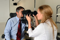 Doctor Examining Man's Eyes Stock Images
