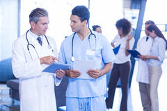 Doctor examining medical report and having a discussion. In hospital Royalty Free Stock Photography