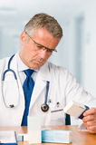 Doctor examining medicine cases Royalty Free Stock Image