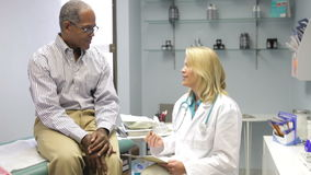 Doctor Examining Middle Aged Male Patient stock footage