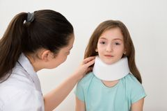 Doctor Examining Neck Of Patient Stock Images