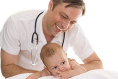 Doctor examining newborn Stock Photography