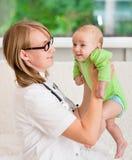 Doctor examining a newborn baby Stock Photography