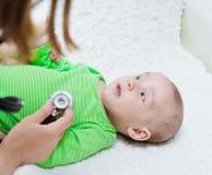 Doctor examining newborn baby with stethoscope Royalty Free Stock Photo