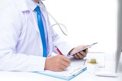 Doctor. The doctor is examining the patient stock photography