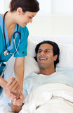 A doctor examining a patient Stock Images