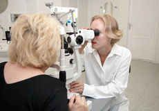 Doctor, examining patient. Doctor,examining a patient in ophthalmology laboratory stock images