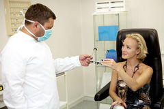 Doctor,examining a patient Stock Photography