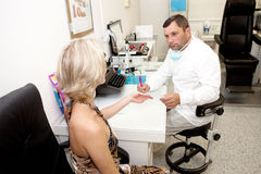 Doctor,examining a patient Stock Photos