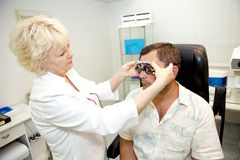 Doctor,examining a patient Royalty Free Stock Image