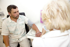 Doctor,examining a patient Royalty Free Stock Photo