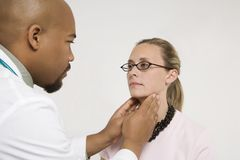 Doctor examining patient. Royalty Free Stock Photo