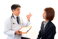 Doctor examining a patient Stock Photo