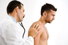 Doctor examining patient Royalty Free Stock Images