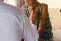 The doctor is examining the patient at rural. Royalty Free Stock Photos