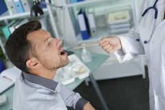 Doctor examining patient in office royalty free stock photo
