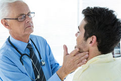 Doctor examining patient jaw. In clinic stock photography