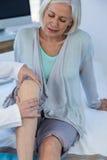Doctor examining patient knee stock photo