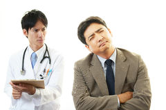 Doctor examining a patient Stock Photography