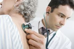 Doctor Examining Patient's Back Using Stethoscope Stock Photography