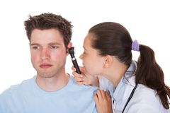 Doctor Examining Patient's Ear Royalty Free Stock Image