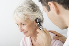 Doctor Examining Patient's Ear Using Otoscope Royalty Free Stock Photo