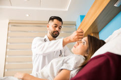 Doctor examining a patient`s ears Stock Photos
