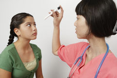 Doctor Examining Patient's Eye Stock Photography