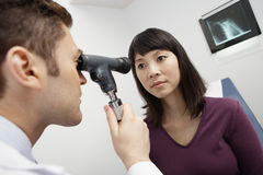 Doctor Examining Patient's Eye Royalty Free Stock Photography