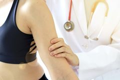 Doctor examining patient, Sport exercise injuries. royalty free stock photo