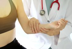 Doctor examining patient, Sport exercise injuries. stock image