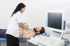 Doctor Examining Patient With Ultrasound Machine In Hospital Stock Image