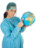 Doctor examining the planet earth Stock Photos