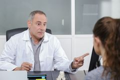 Doctor examining pointing at screen royalty free stock photography