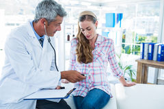 Doctor examining a pregnant woman with a stethoscope Royalty Free Stock Photos