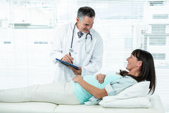 Doctor examining a pregnant woman Stock Image