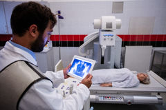 Doctor examining x-ray on digital tablet Royalty Free Stock Photos