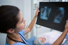 Doctor examining a x-ray. In hospital Stock Photos