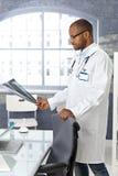 Doctor examining x-ray image Stock Photos