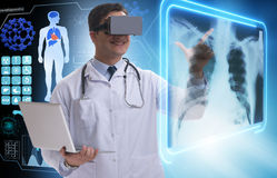 The doctor examining x-ray images using virtual reality glasses. Doctor examining x-ray images using virtual reality glasses Royalty Free Stock Images