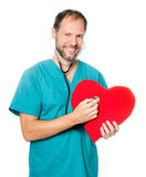 Doctor examining a red heart Royalty Free Stock Images