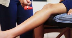 Doctor examining reflexes of patient knee 4k