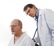Doctor Examining Senior Male Patient Royalty Free Stock Photos