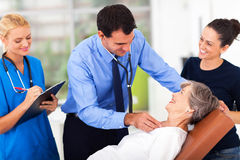Doctor examining senior Stock Photos