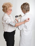 Doctor examining senior patient Stock Photo
