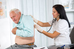 Doctor examining a senior patient Stock Images