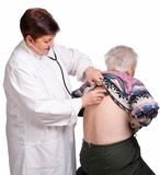 Doctor examining senior woman Stock Image