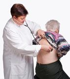 Doctor examining senior woman Royalty Free Stock Image
