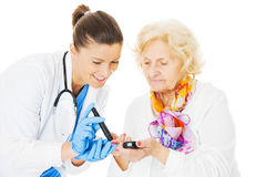 Doctor Examining Senior Woman's Blood Sugar Stock Photography