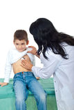Doctor examining small boy Stock Photo